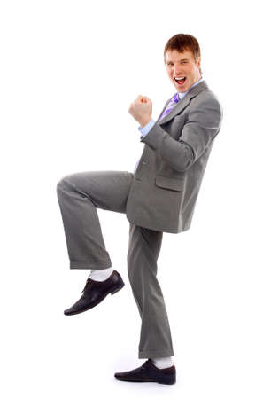 happy businessman: One very happy energetic businessman with his arms raised