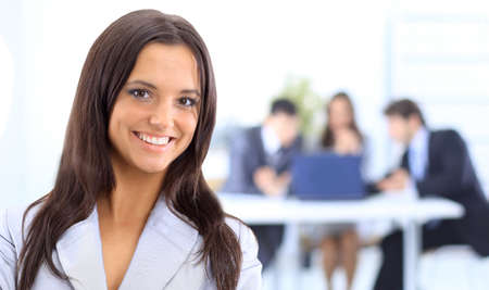 Face of beautiful woman on the background of business people  photo
