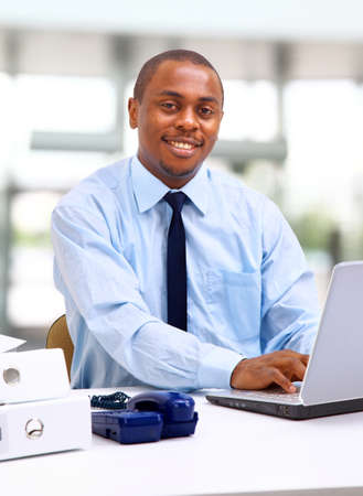 Portrait of a handsome young business man with a laptop  Stock Photo - 11315083
