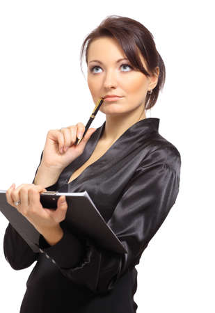 woman thinking: Portrait of a young female entrepreneur thinking while taking notes against white background  Stock Photo