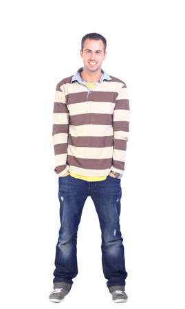Young man standing with hands in pockets  photo