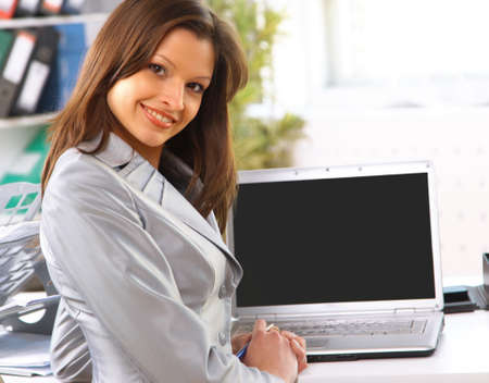 presentation screen: Young business woman showing blank laptop screen ready for your text and promotion
