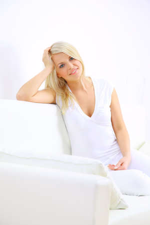 Young blond lady laying in a bedroom  photo
