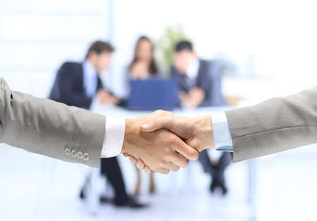 sales executive: handshake isolated on business background