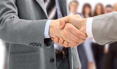 personas saludandose: apret�n de manos aislado en el fondo de negocio Foto de archivo