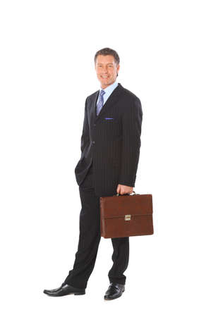 Full length portrait of a successful mature business man with hands folded isolated on white  photo