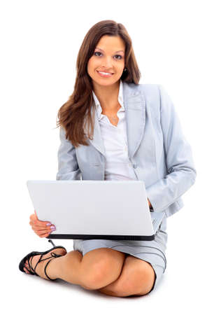 young woman is lying on the floor and working on a laptop Stock Photo - 11315645