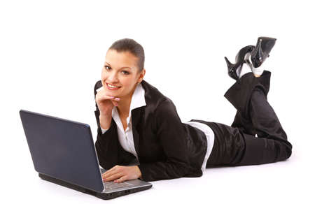 young woman is lying on the floor and working on a laptop  Stock Photo - 11315633