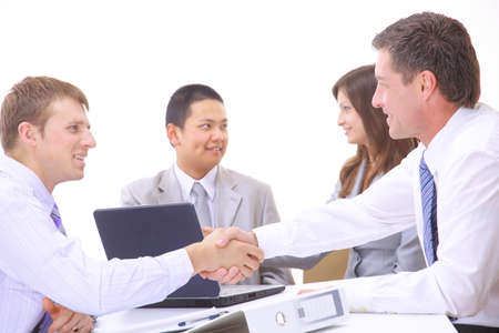 Business people shaking hands, finishing up a meeting  Stock Photo - 11315673