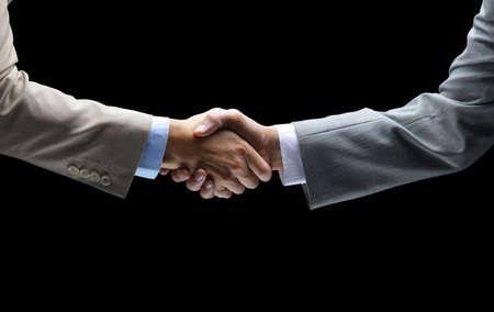 Handshake - Hand holding on black background  photo