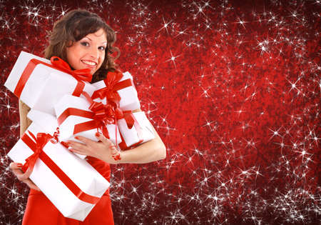 hot sale: Portrait of a beautiful young woman wearing christmas clothes over sky of stars and snow.  Stock Photo