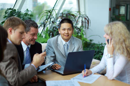 Team of multi ethnic business people discussing work  Stock Photo - 11315699