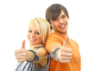 Portrait of a young teenage couple smiling against white background photo