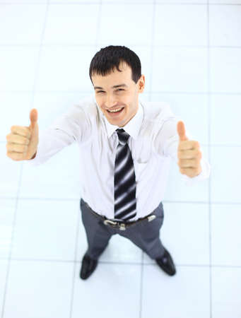 Happy businessman standing outside with arms outstretched  photo