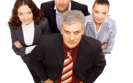 Top view of a smiling group of business people standing together and looking up  photo