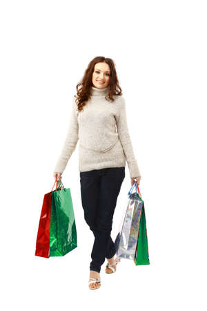 woman holding shopping bags against isolated white background   photo