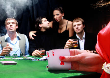 poker cards: group of sinister poker players Stock Photo