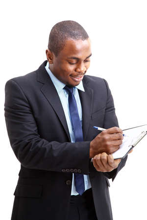Portrait of a handsome successful business man busy working  photo