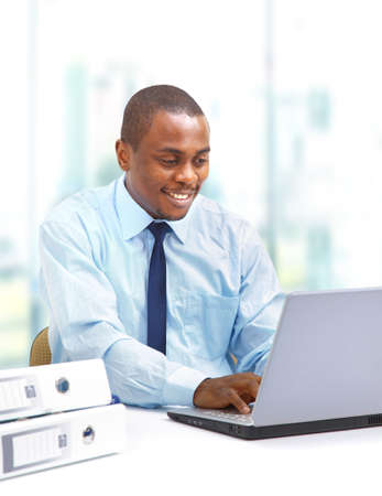 modern businessman: Portrait of a handsome young business man with a laptop  Stock Photo