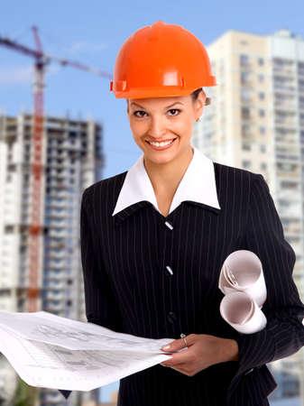 Female architect holding blueprints Stock Photo - 11315946