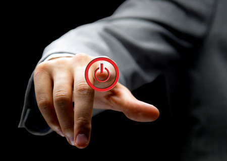 turn off: Hand press power button on touch screen  Stock Photo