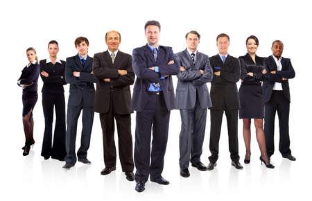 grupo de personas: equipo comercial formado por j�venes empresarios y empresarias de pie sobre un fondo blanco