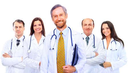 equipe medica: Ritratto di gruppo di colleghi in ospedale sorridente in piedi insieme