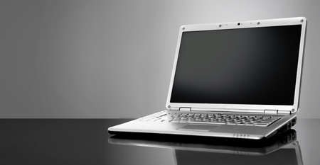 Modern laptop isolated on black background photo