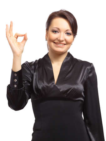 Portrait of a happy young female entrepreneur showing thumbs up sign against white background  photo