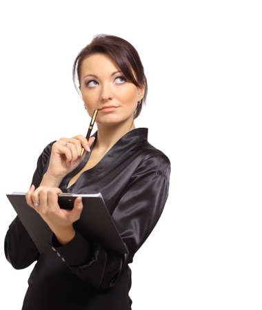 taking notes: Portrait of a young female entrepreneur thinking while taking notes against white background  Stock Photo