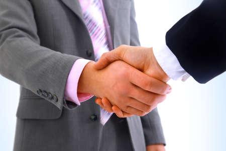pacto: apretón de manos aisladas sobre fondo blanco Foto de archivo
