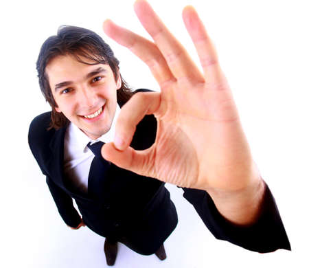 job satisfaction: young business man going thumb up, isolated on white Stock Photo