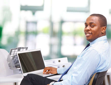 african hair: Portrait of a handsome young business man with a laptop