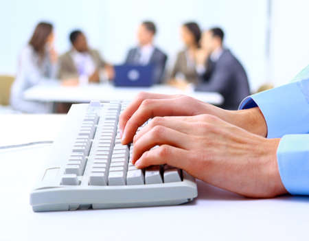 office use: Image of male hands typing on keyboard in a working environment