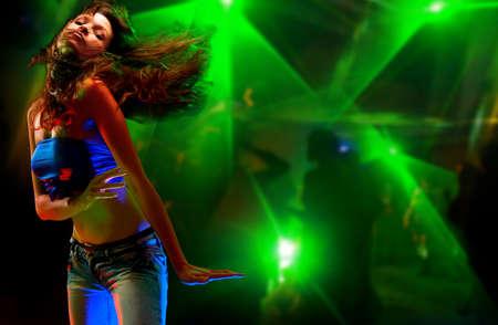 Beautiful young woman dancing in the nightclub  Stock Photo