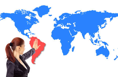 Happy young woman pointing on map photo