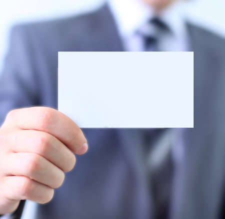 Paper card in man hand isolated on white background Stock Photo - 11320345