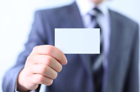 Businessman's hand holding blank paper business card Stock Photo - 11320404