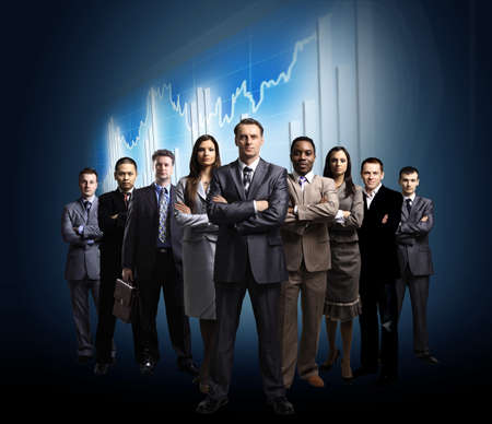 serious businessman: business team formed of young businessmen standing over a dark background
