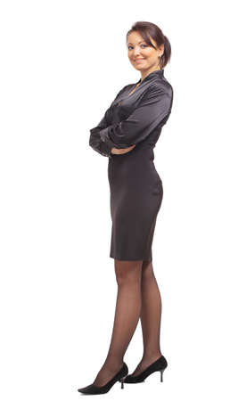 skirt suit: Full length portrait of a beautiful business woman standing with hands folded over white background