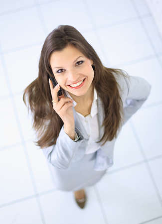 good life: Portrait of a beautiful business woman talking on her mobile phone Stock Photo