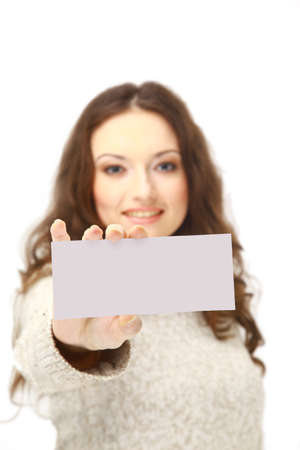 Young woman holding an empty billboard over white background Stock Photo - 11357085