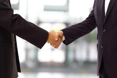 handshake isolated on blue background  photo