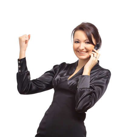 Portrait of a happy young businesswoman talking on cellphone against white background  photo