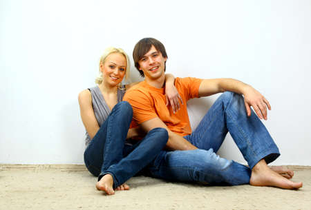 young add: Young love smiling couple in the new flat