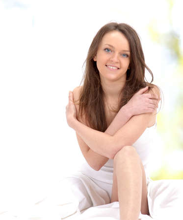 Portrait of smiling blonde woman on the bed.  Stock Photo - 11479874