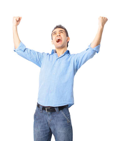 excited man: Portrait of a very happy young man with his arms raised
