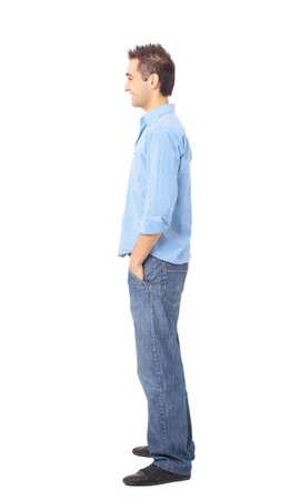 young man standing: Giovane uomo in piedi con le mani in tasca