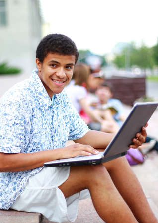 A smiling african american man on his laptop photo