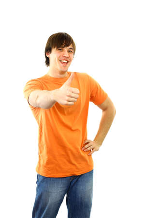 Portrait of a smart young guy gesturing a thumbs up on white background   Stock Photo - 11480549